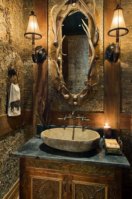 cabin bathroom with an antler mirror frame