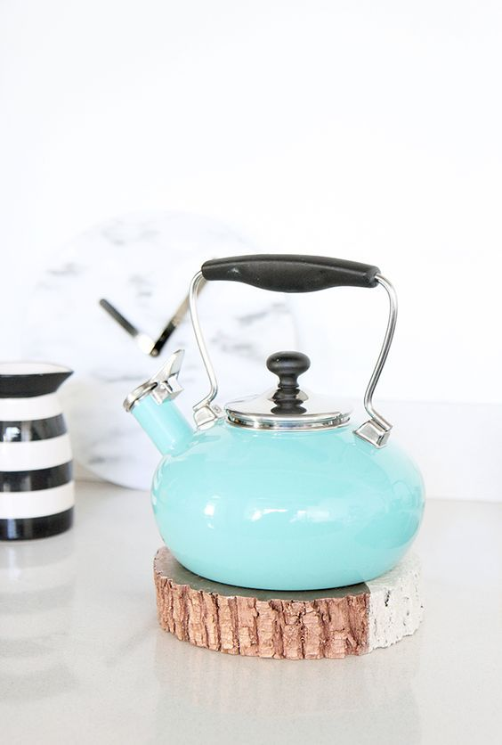 copper and white teakettle trivet