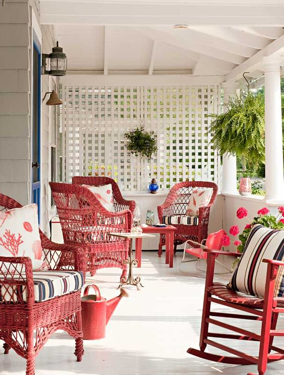 red and white cottage porch with red furniture