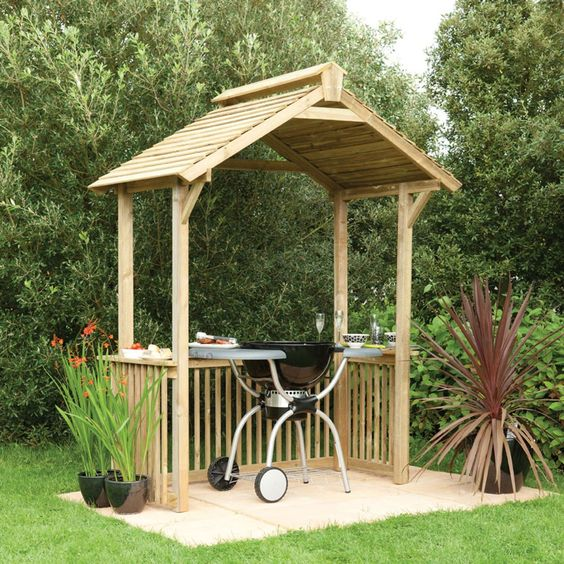 wooden BBQ shelter with shelving