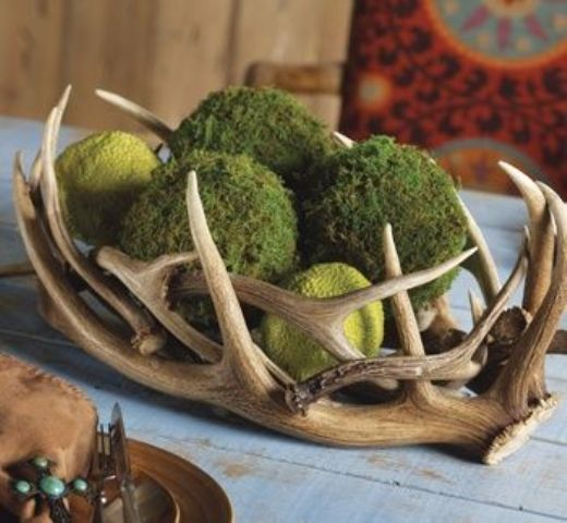 Luxury centerpiece made of antlers and moss balls