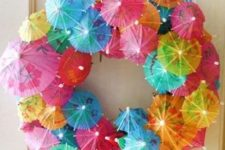 21 cocktail umbrella wreath for a pool party
