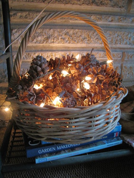 low basket for displaying pinecones and lights perfect for christmas decor