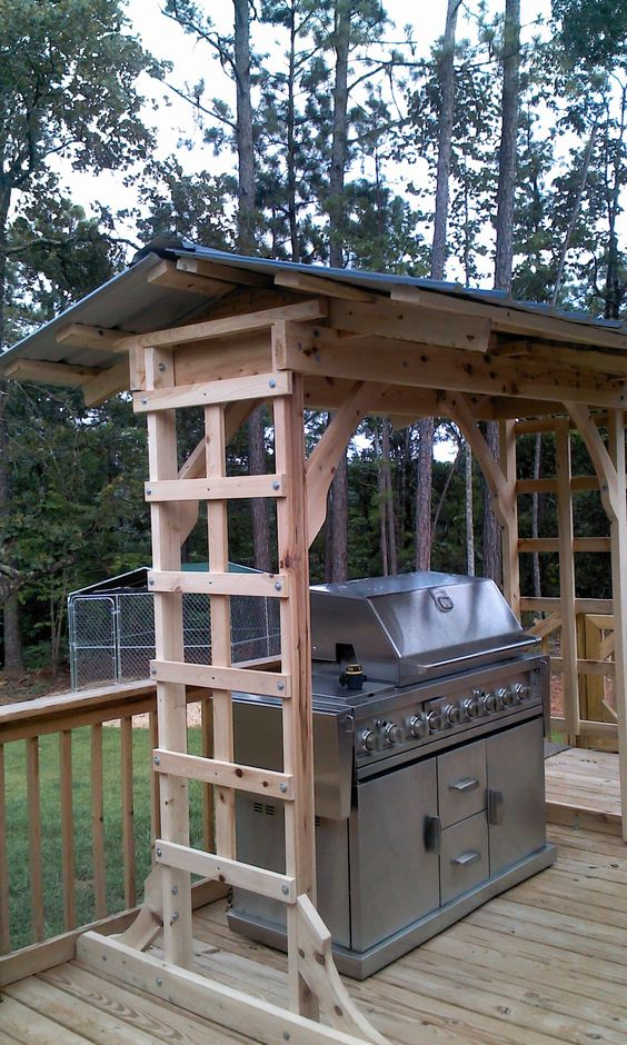 wooden grill cover to use climbing plants on its sides