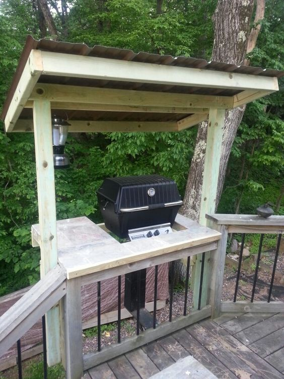 wooden grill cover with wooden shelves