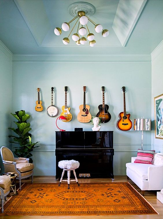 guitars displayed as decor on the wall