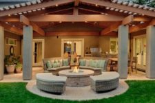 23 roofed back porch with a fire pit and a conversation area