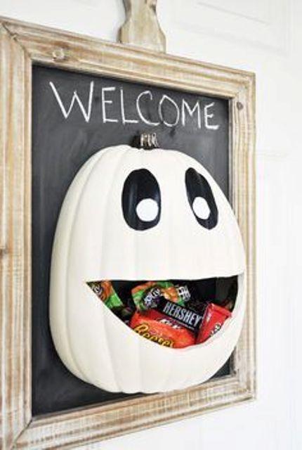 Halloween candy door hager with a voluminous white pumpkin