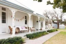 24 white warp around porch with wicker furniture for a relaxed feel