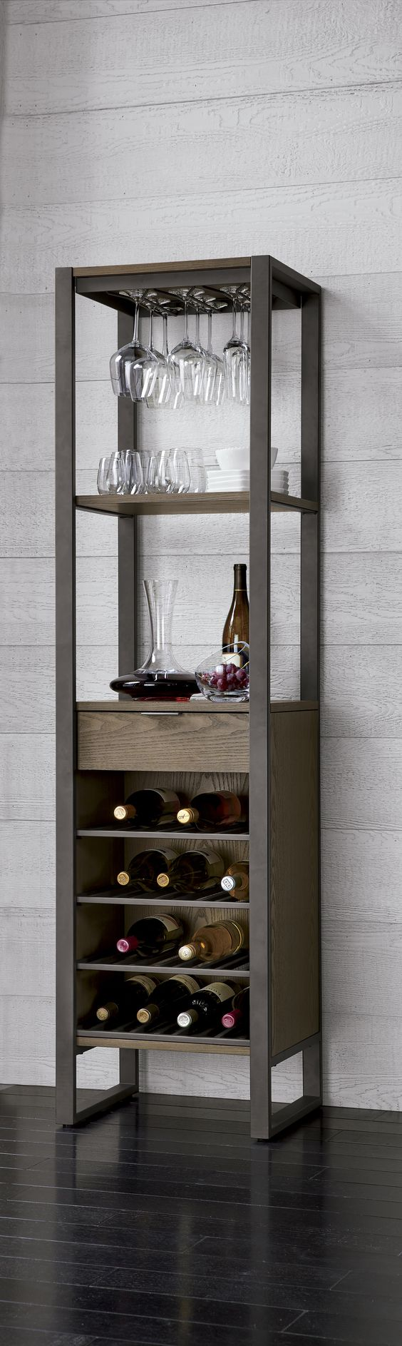 wine tower with bottles in the lower part and glasses in the upper part
