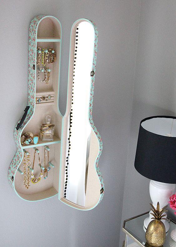 a wall mounted shelf made of a guitar case