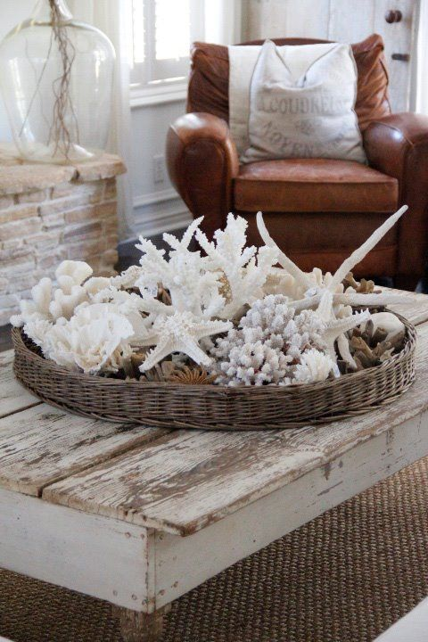 wicker basket on coffee table filled with shells for a coastal look