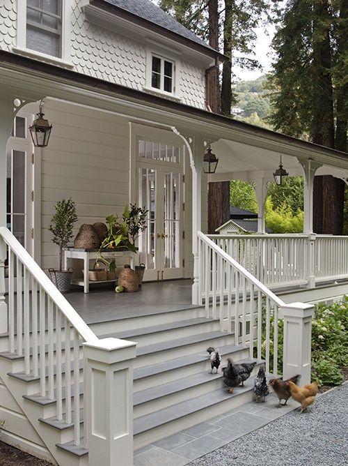 wraparound porch with hanging lanterns - beeskeeps