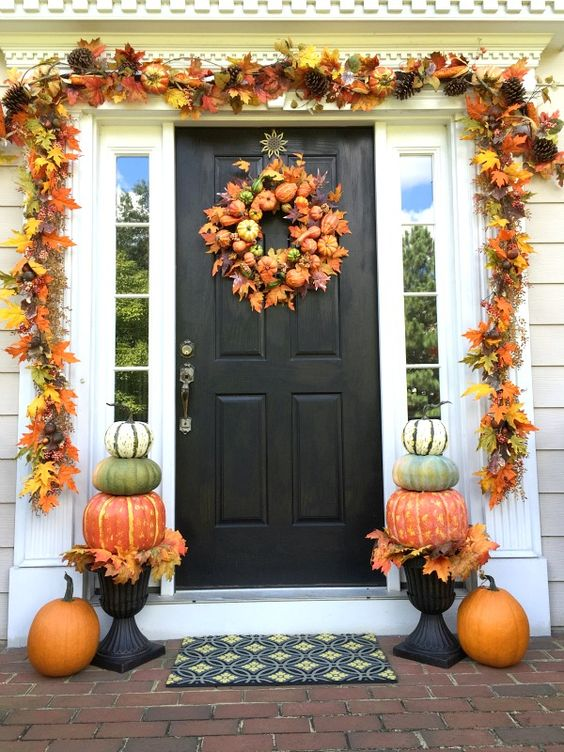 pumpkin topiaries, a leaf garland,a fall wreath with mini gourds