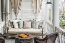 26 this neutral-colored porch is a cozy reading nook with wicker furniture
