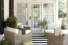 28 wicker furniture here creates a relaxed ambience perfect for enjoying outdoors