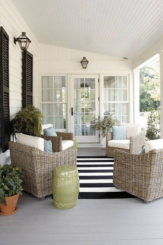 wicker furniture here creates a relaxed ambience perfect for enjoying outdoors