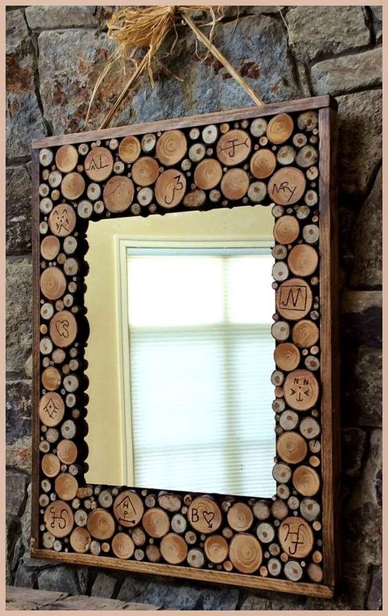 mirror frame made of slices and decorated with wood-burning