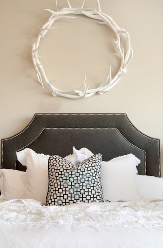 Perfect white antler wreath for an accent in the bedroom