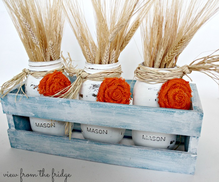 DIY distressed white mason jar vases for a centerpiece (via www.ohmy-creative.com)
