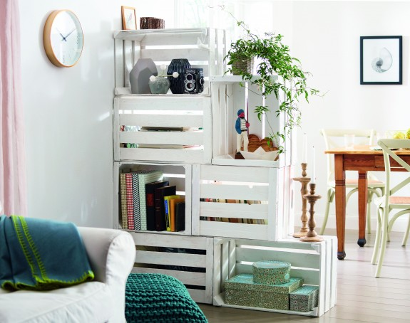 DIY whitewashed crate space divider that functions as a shelf