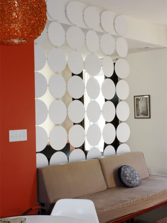 DIY hanging space divider from old vinyl LPs (via www.apartmenttherapy.com)