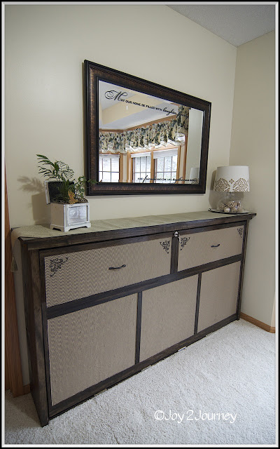 DIY murphy bed looking as a dresser (via www.remodelaholic.com)