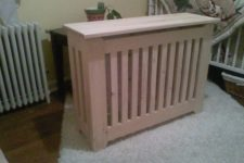DIY energy-efficient radiator cover of pine wood
