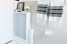DIY all-white radiator cover with a decorative metal sheet