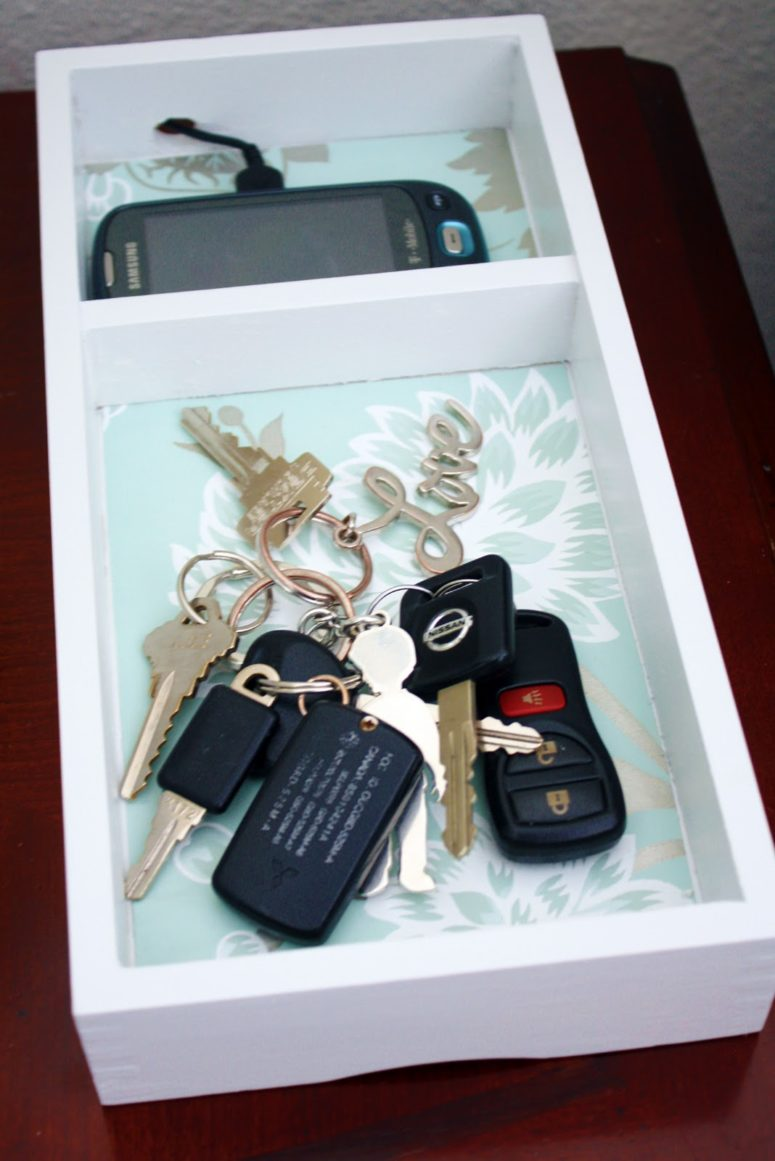 DIY charging box with a keys compartment (via www.iheartorganizing.com)