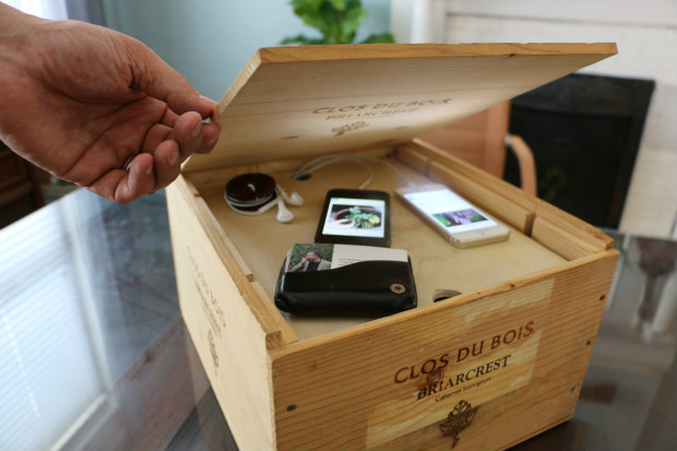 DIY charging station from a wine crate (via www.ehow.com)