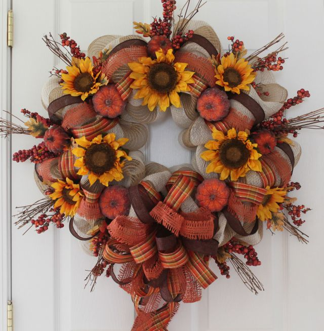 DIY wreath mad eof several types of mesh and faux pumpkins (via www.thewreathdepot.com)