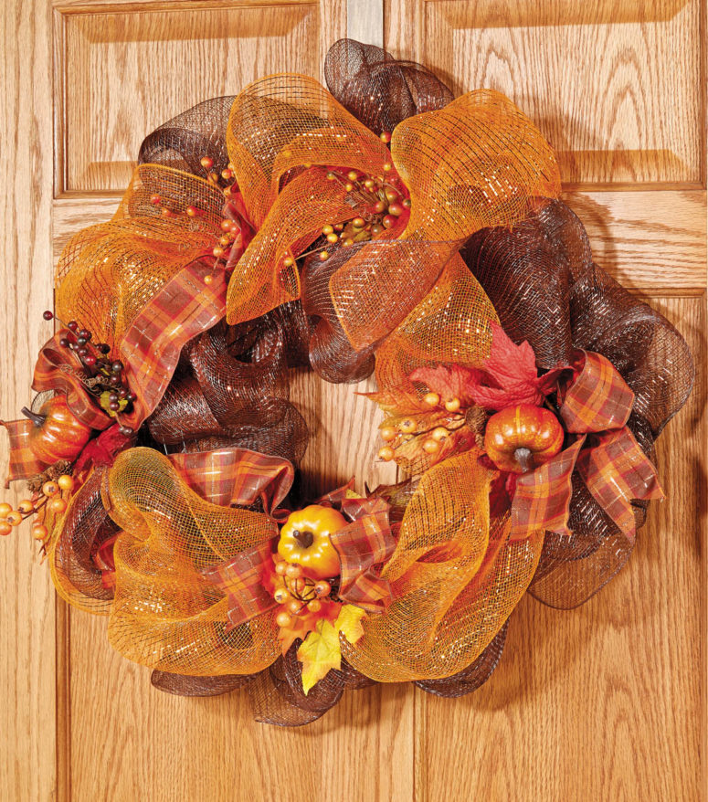 DIY fall-colored deco mesh wreath with faux veggies (via www.joann.com)