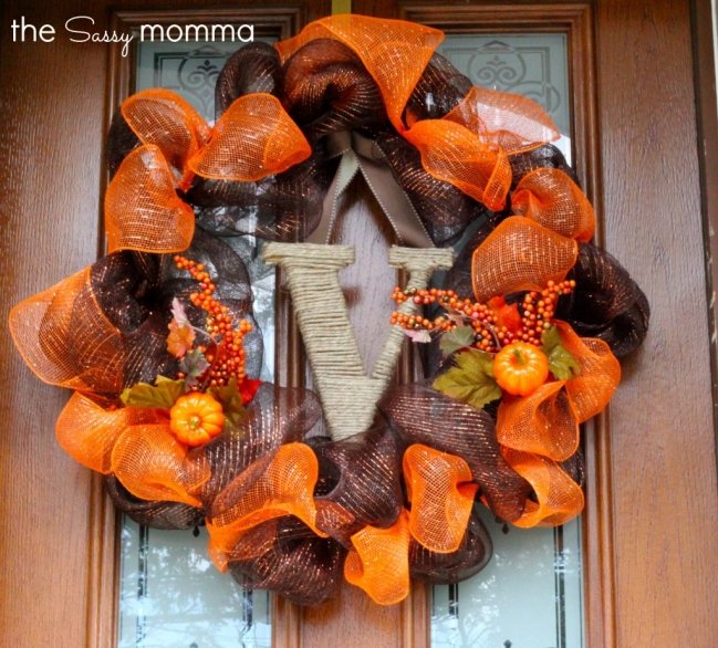 DIY brown and orange deco mesh wreath with a twine letter (via thesassymomma.com)