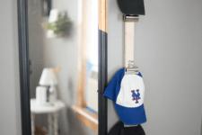 DIY baseball cap storage using bulldog clips