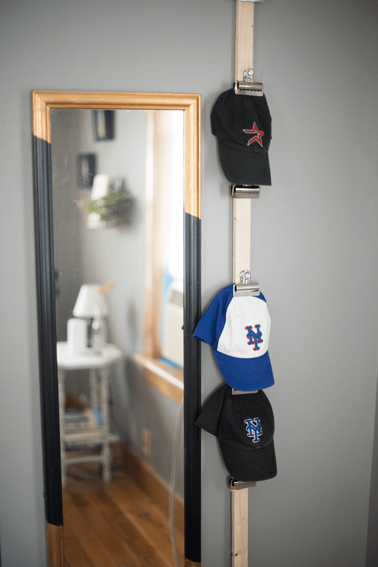 DIY baseball cap storage using bulldog clips (via www.autostraddle.com)