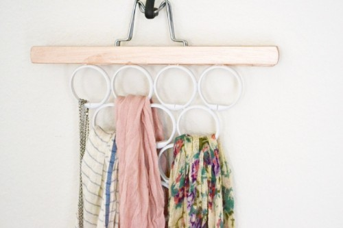 DIY scarf and accessory hanger from a pants holder and shower curtain rings