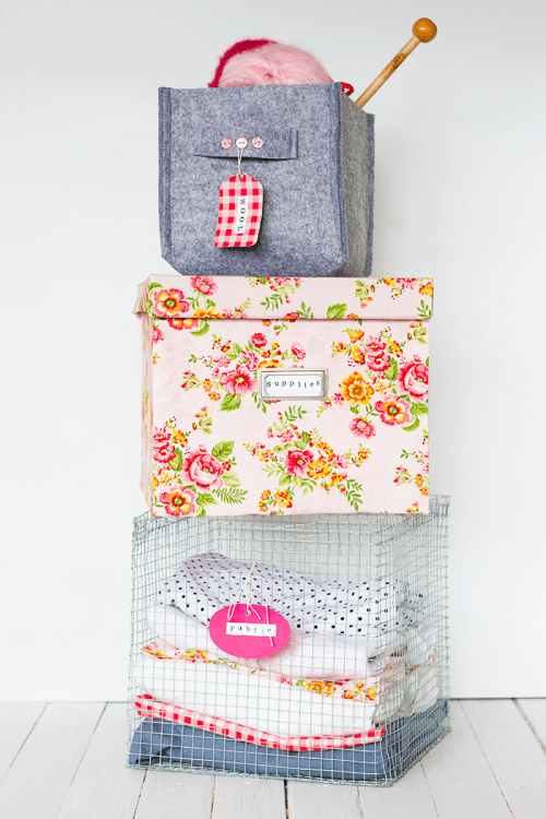 DIY storage boxes covered with fabric and paper