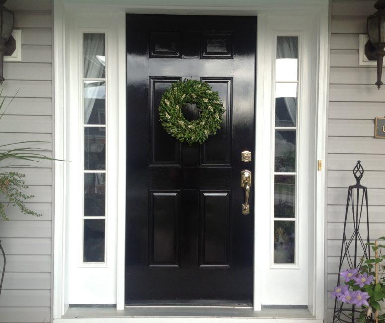 DIY stylish glossy black door repaint (via www.blogher.com)