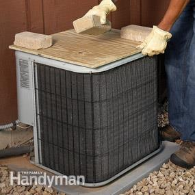 DIY AC condenser cover unit of plywood (via www.familyhandyman.com)