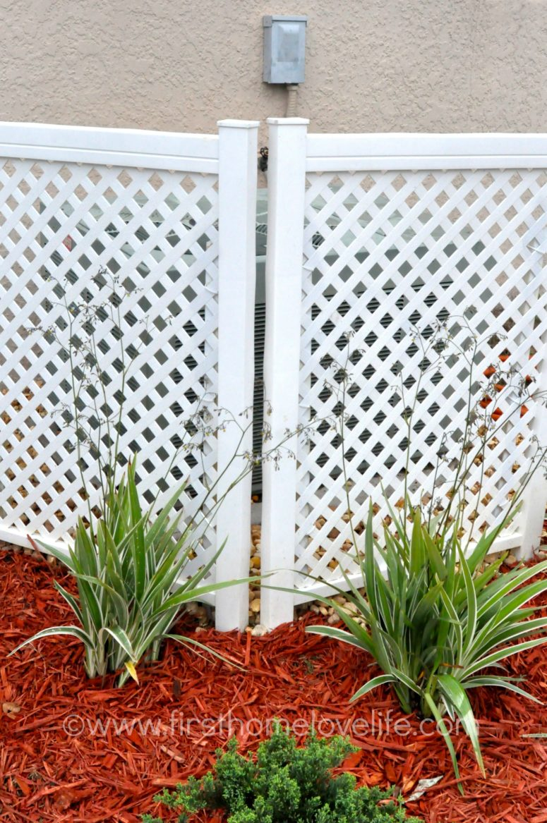 DIY AC unit cover of plastic privacy lattice screens (via www.firsthomelovelife.com)