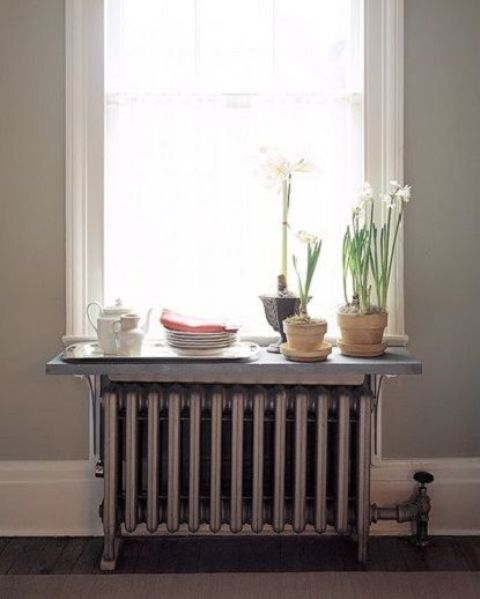 shelf placed on the radiator and used as a window sill