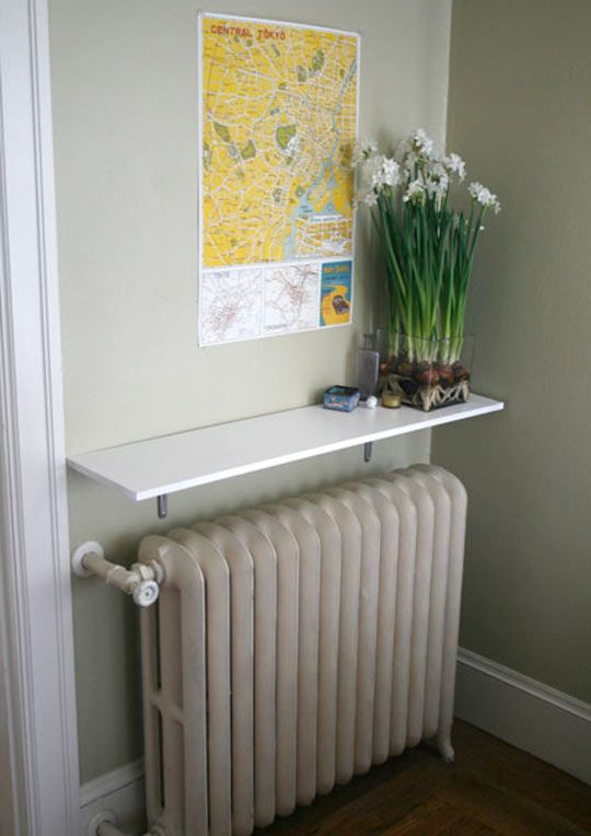 wall-mounted shelf over the radiator to display things and plants
