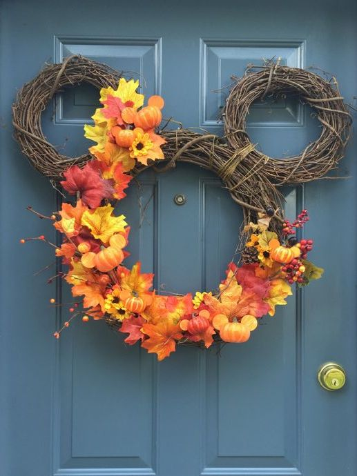 Cool mickey-shaped fall wreath with faux leaves and pumpkins