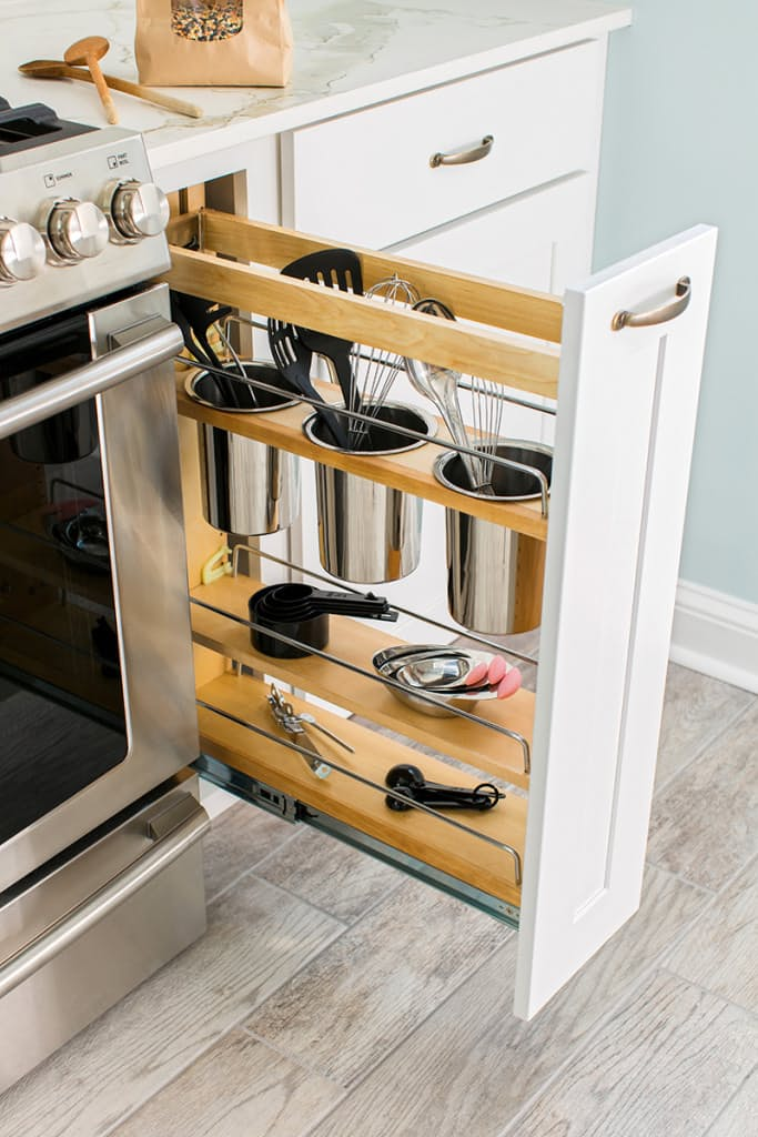 narrow pull-out cabinet next to the cooker