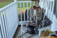 02 spooky skeleton on your porch with a cauldron with sweets