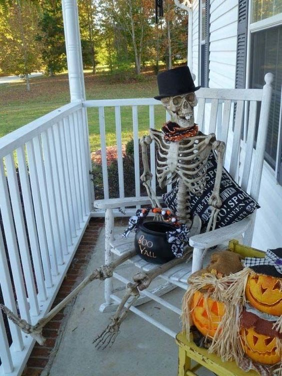 spooky skeleton on your porch with a cauldron with sweets