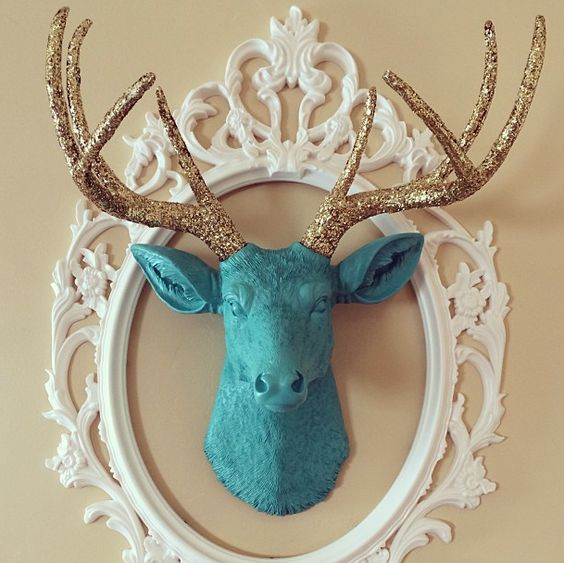 a usual dollar store head can be glam with glitter antlers and a frame