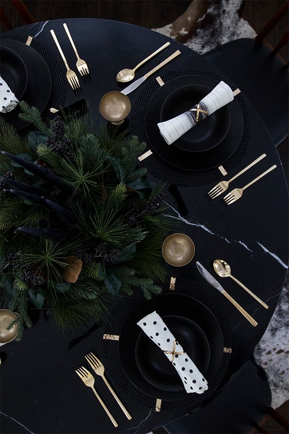 chic modern black tablescape with fir branches