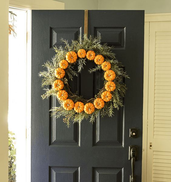 faux pumpkins and greenery wreath